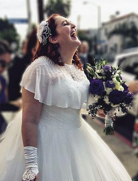 carma in a wedding dress laughing joyfully