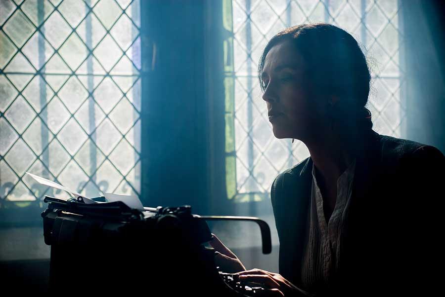 writer at a typewriter