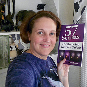 Carma posing with book 57 Secrets for Branding Yourself Online