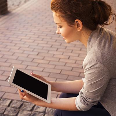 a woman reading a tablet
