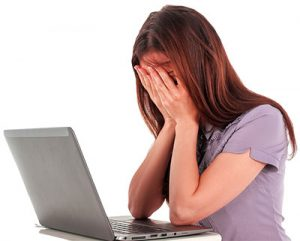frustrated woman at a computer